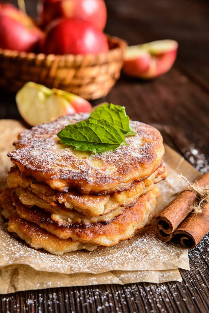 Low Carb Cinnamon Apple Pancakes on a plate with powdered sugar.