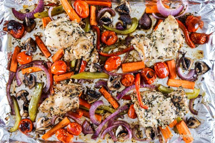 Roasted Balsamic Chicken and Vegetables in a foil lined baking sheet.