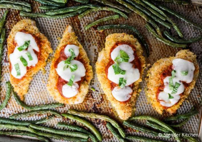 An easy sheet pan meal with chicken parmesan and green beans.