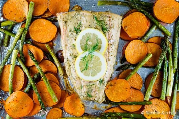 Salmon, sweet potatoes, and asparagus cooked together for a healthy sheet pan dinner.