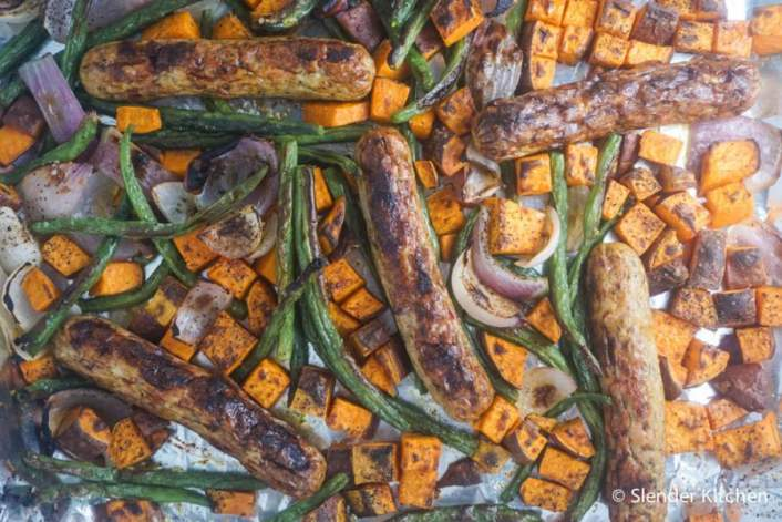 a simple sheet pan supper with sausage, sweet potato, and green beans.