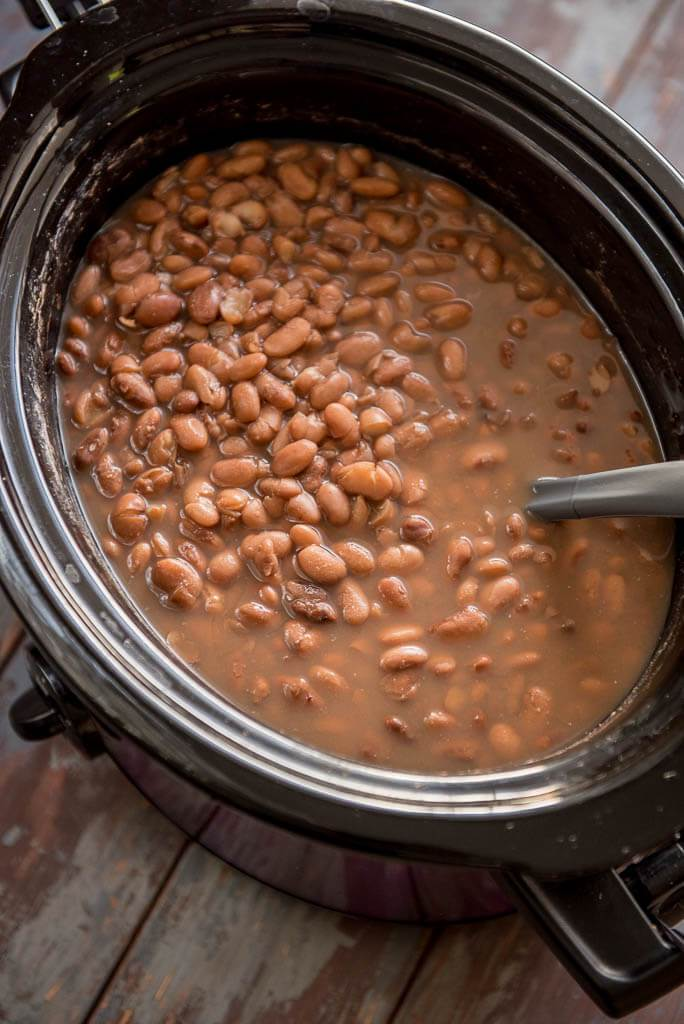 Slow Cooker Pinto Beans in purple and black slow cooker