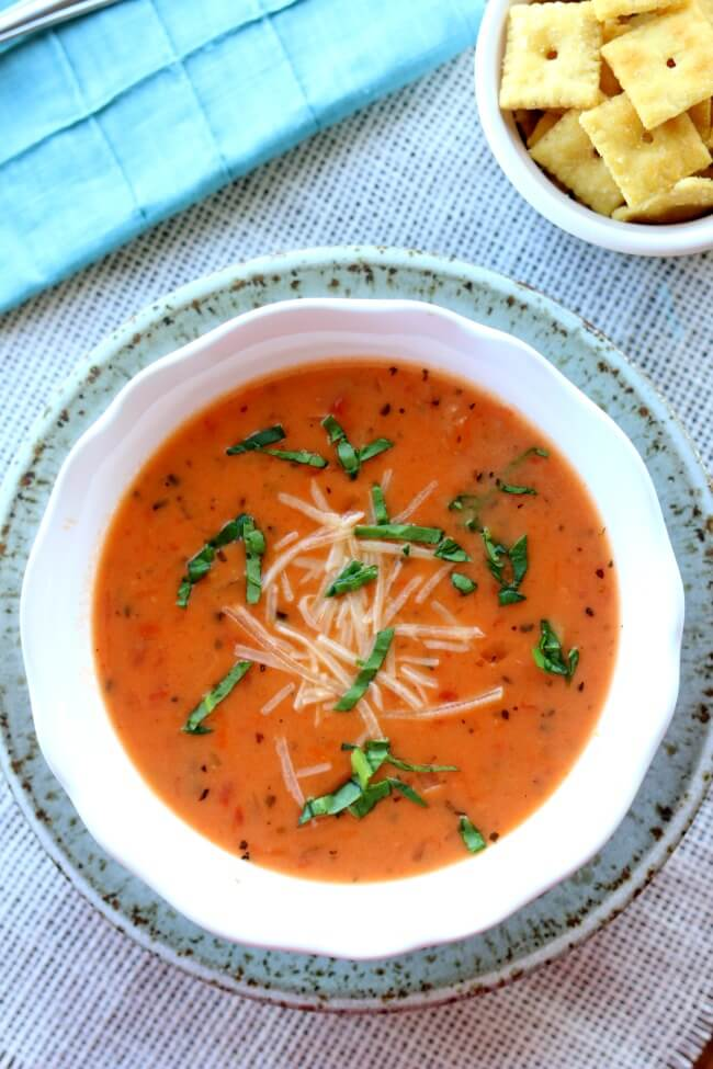 Instant Pot Tomato Basil Parmesan Soup-- a creamy tomato based soup that is made from start to finish in 45 minutes thanks to the help of your pressure cooker. This is my favorite soup to make for company. I always get tons of compliments. I don't believe I've tasted soup at a restaurant that is as good as this version.