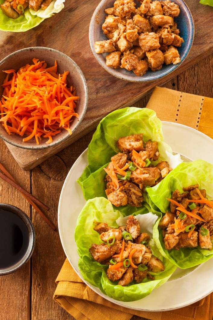 Weight Watchers Slow Cooker Korean Chicken served in lettuce wraps with carrots.