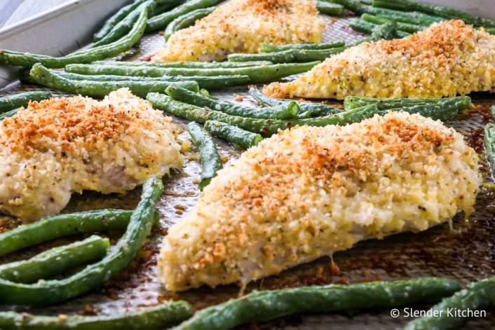 Lemon Pepper Chicken with green beans on a sheet pan.