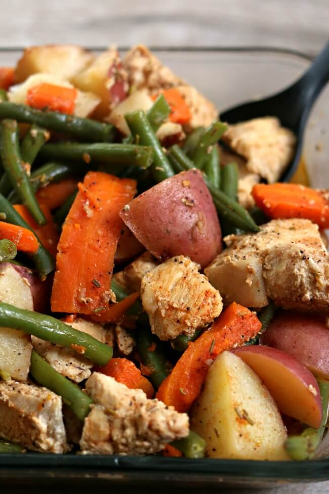 Slow Cooker Homestyle Chicken and Vegetables--well seasoned chicken, green beans, red potatoes and carrots are all cooked together in your slow cooker. A true one pot meal that is family friendly, tastes amazing and is so easy to put together.