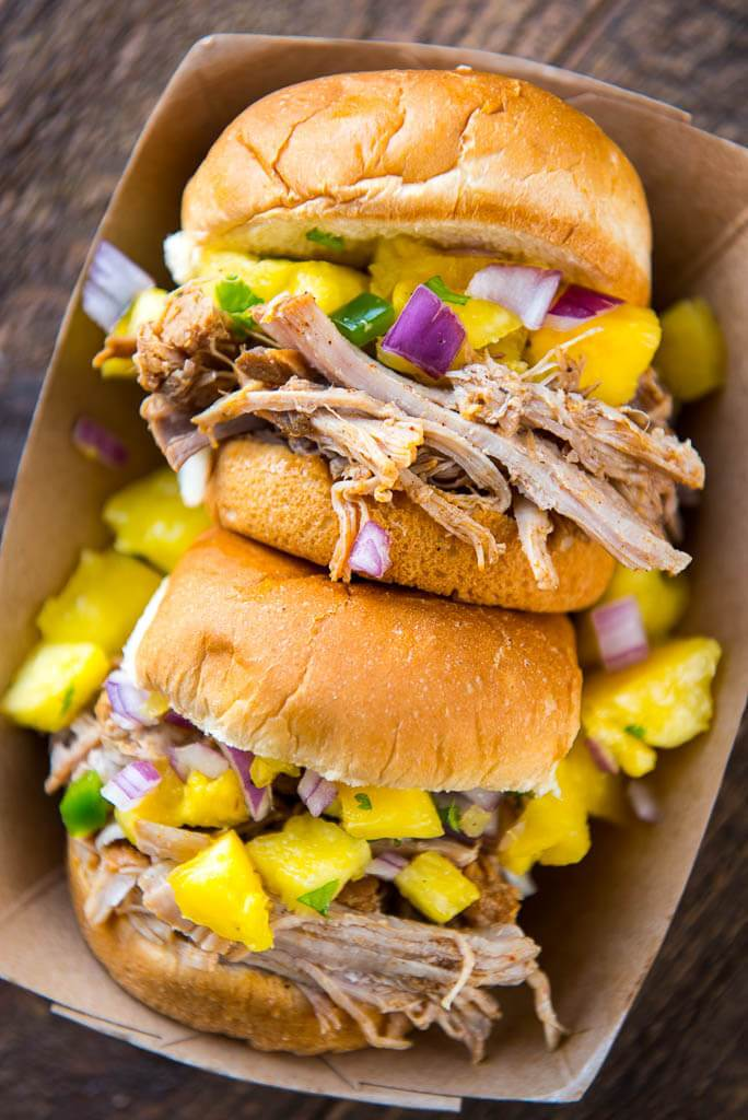 Pressure Cooker Pulled Pork Sandwiches topped with pineapple salsa