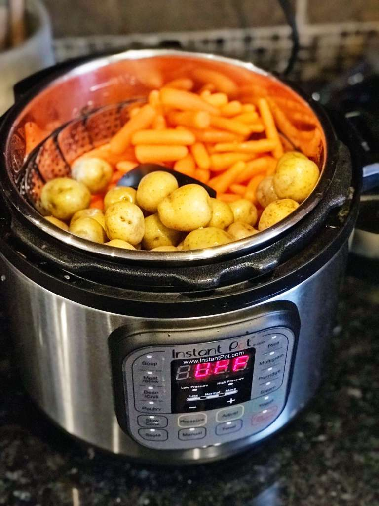 potatoes and carrots on steamer basket in Instant Pot